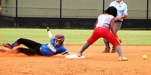 Chamblee's Anna Burk (left) hangs on to the base as she slides in with a steal. Clarke Central's Za'mya Sims (3) could not come up with the low throw. (Photo by Mark Brock)