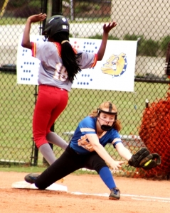 Chamblee's Mary Axelson was big at the plate (6-6 on the day with 7 RBI), but also made plays in the field like this nice stretch covering first on a bunt from her second base position. (Photo by Mark Brock)
