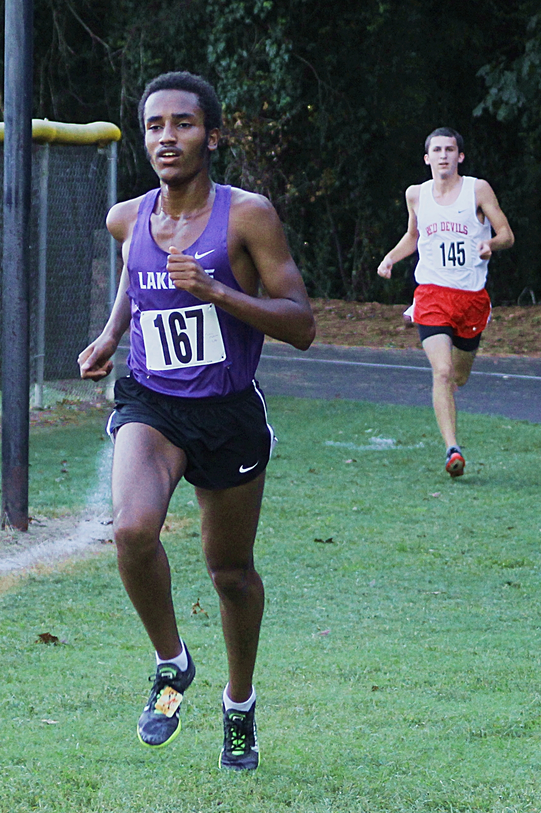 Lakeside junior Mikias Mekonen (left) pulls away from Druid Hills' senior Carter Rathur on the way to the country's fastest time. (Photo by Mark Brock)