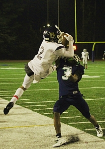Southwest DeKalb's Aquil Muhammad (2) tries to come down with a catch against Arabia Mountain's D'Anthony Garrett (3). (Photo by Mark Brock)