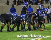 Stephenson quarterback Joseph Jackson (15) calls signals out as his lineman prepare to block. (Photo by Travis Hudgons, iShoot Atlanta Sports Photography)
