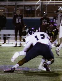 Cedar Grove defensive end Dante Walker (12) pickes up one of the Saints' tackles for a loss against Benedictine in their Class 3A quarterfinal clash. (Photo by Mark Brock)