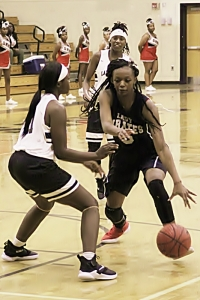 Stone Mountain's Jardyn Alexander (5) dribbles against Cedar Grove's Antoniya Hicks (41). Alexander finished the night with 34 points and 10 rebounds in the 57-55 overtime win. (Photo by Mark Brock)