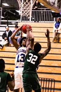 Chamblee's Zachary Mackson (13) goes up for two of his game-high 23 points against Arabia Mountain's Khalil Roach. (Photo by Mark Brock)