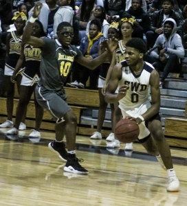 Southwest DeKalb's KD Johnson (0) drives past Lithonia's Brison Rockcliffe (10). Johnson would get his best assist of the night moments later for the game-winner by Wytavis Searcy. (Photo by Mark Brock)