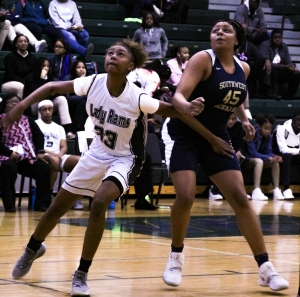Arabia Mountain's Kennedi Manning (23) and Southwest DeKalb's Taylor Christmas (45) battle for rebounding position on a free throw during the Lady Panthers big Region 5-5A win. (Photo by Mark Brock)