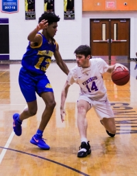 Chamblee's Zachary Mackson (13) cuts off Lakeside's Eli Chandler (14) during second half action of Lakeside's 64-59 win. (Photo by Mark Brock)