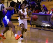 Columbia's India Terrell (2) defends against Miller Grove's Jalisa Mann (11) during the Lady Eagle's 52-44 win. (Photo by Mark Brock)