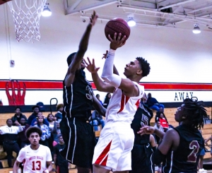 Justin Fleming drives for two of his 21 points that led Druid Hills to a big Region 4-4A boys' basketball win over No. 9 ranked Salem. (Photo by Mark Brock)
