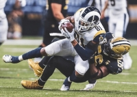 Los Angeles Rams tight end and Columbia High alum Gerald Everett (81) comes down with one of his two catches in the NFC Championship game win over the New Orleans Saints. (Photo by Hiro Ueno/Rams)