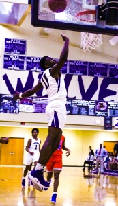Zyair Greene's second half performance propelled the Miller Grove Wolverines to a 62-51 Region 5-5A boys' basketball win over Columbia. (Photo by Mark Brock)