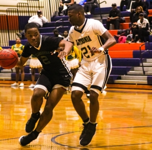 Clarkston's Brenden Middlebrooks works to get around Columbia's N'Kyzie Hawkins (21). (Photo by Mark Brock)