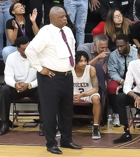 Nineteen year Tucker Head Coach James Hartry keeps an eye on his defense during the Tigers' big win against Gainesville. (Photo by Lester Wright)