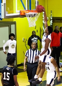 Southwest DeKalb's KD Johnson (0) with a dunk as part of his game-high 20 points to lead the Panthers to a 63-51 win over Carrollton. (Photo by Lester Wright)