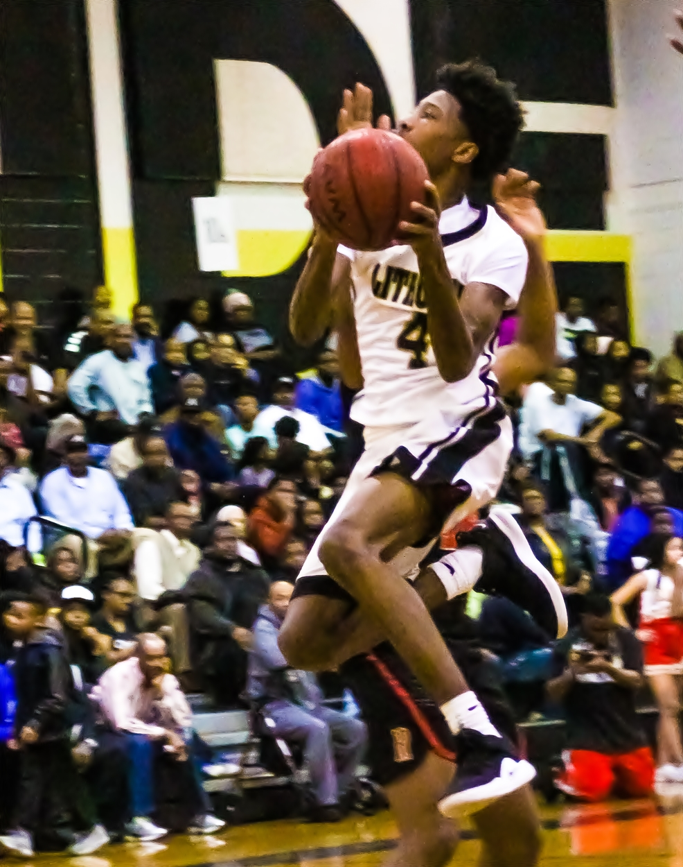 Lithonia's Eric Gaines (4) drives for two of his 27 points in the Bulldogs 67-54 win over the Rome Wolves. (Photo by Mark Brock)