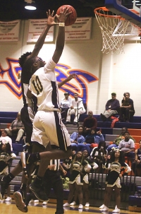 Lithonia's Bryson Rockcliffe (10) makes a layup during the Region 5-5A boys' tournament. Rockcliffe helps lead his Bulldog teammates into a second round clash with Rome on Thursday at 6:00 pm. (Photo by Mark Brock)