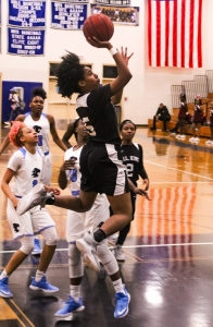 Martin Luther King's Ashlynn Green (5) goes airborn to the basket against Lovejoy. (Photo by Mark Brock)