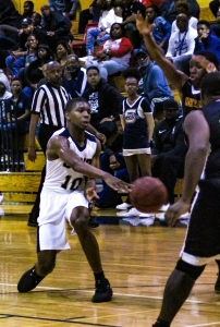 Southwest DeKalb's Jarrett Walton (10) makes a pass into the lane against Clarke Central. (Photo by Mark Brock)