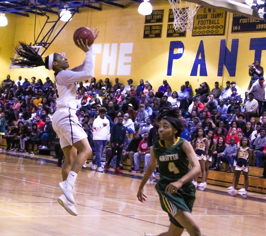 Southwest DeKalb's Raven Thurman (with ball) scored the Lady Panther's first six points of the second half. Griffin's Dais'ya Reid tries to head off Thurman. (Photo by Mark Brock)