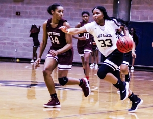 Cedar Grove's Antoniya Hicks (33) dribbles up court in a hurry against Towers' Kevani Jackson (14) during the Lady Saints' 57-18 win. (Photo by Mark Brock)