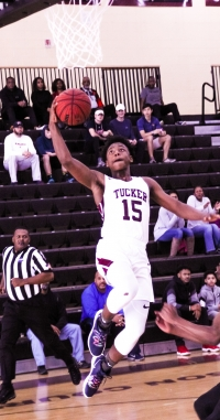 Tucker's Raylon Barrian (15) scored 10 points in a big 16-0, first quarter run by the Tigers in their opening round win over Valdosta in the Class 6A state basketball playoffs. (Photo by Mark Brock)