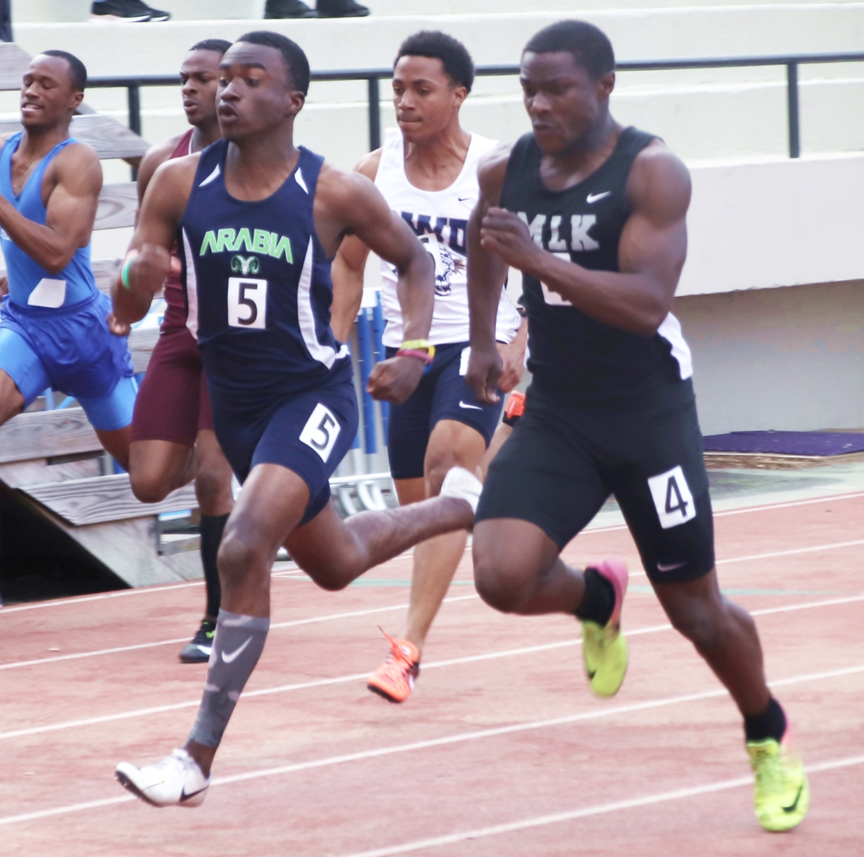 Arabia Mountain's Jordan Barrow (left) took gold in the 200m dash in Class 5A while Martin Luther King's Jhivon Wilson took a silver in the Class 6A 100m dash and a bronze in the 200m dash. (Photo by Mark Brock)