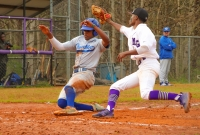 Chamblee's Travis Hammond (left) slides in safely ahead of a throw to Miller Grove's Jathan Smith. (Photo by Mark Brock)