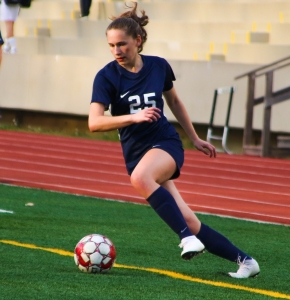 Dunwoody's Camryn Lampron keeps the ball in play during second half action of the Lady Wildctats' 2-0 win over North Atlanta. Lampron scored the opening goal of hte game for Dunwoody. (PHoto by Mark Brock)