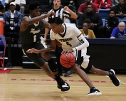 Lithonia's Eric Gaines (4) drives against Fayette County's King Calhoun (1) during second half action of Lithonia's overtime loss in the Class 5A boys' state semifinal game. (Photo by Mark Brock)