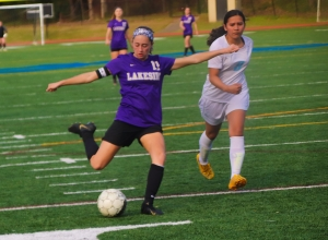 Lakeside's Olivia Cohen delivers a shot for one of her three goals in the Lady Vikings 10-0 win over Meadowcreek. (Photo by Mark Brock)