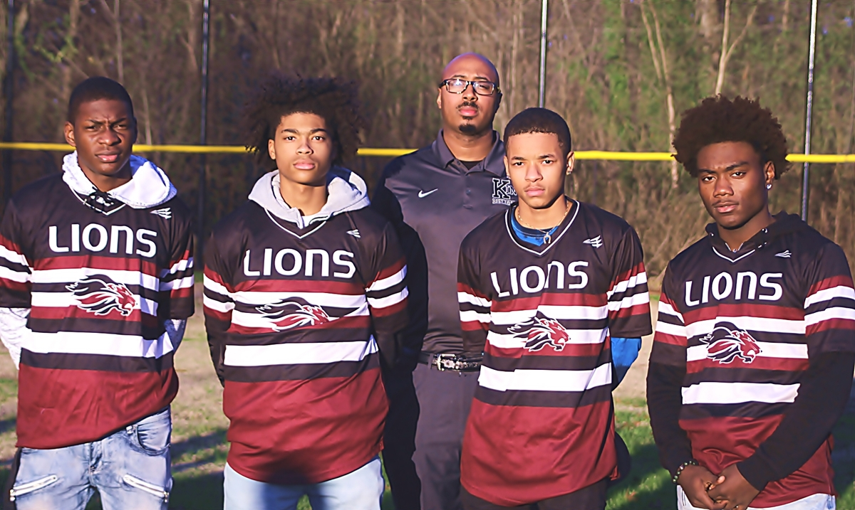 Martin Luther King Jr. Lions players (Front, l-r) Varick Lawrence, Antoine Lloyd, Lamont Barner and Jeremy Cain all played a big role for Coach Greg Boatwright (back row) during the Lions two big Region 4-6A wins during Week 5 of the baseball season. (Photo by Mark Brock)