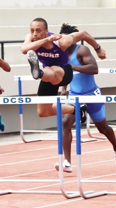 Miller Grove's Walik Robinson clears a hurdle on the way to the gold in the 110 meter hurdles. (Photo by Mark Brock)
