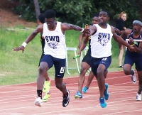 Southwest DeKalb's Jalon Kimbrough (left) takes the baton from teammate Tommy Wright on the way to the gold in the 4x100-meter relay. (Photo by Mark Brock)