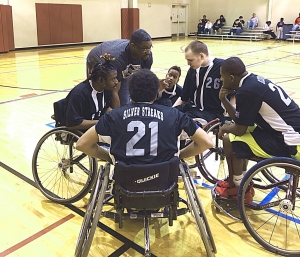 Strategy talk during a timeout against the Houston Jr. Sharks.