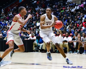 Tucker's Nate Ogbu (10) drives baseline against Tir-Cities Mario McIntosh (3) during first half action of their Class 6A boys' championship thriller. (Photo by Janette Brock)