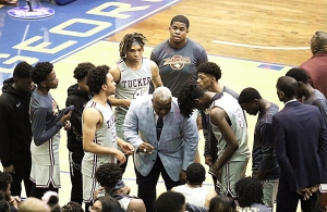 Coach James Hartry talks to his team during their Class 6A boys' basketball state semifinal 52-46 win against Heritage. (Photo by Lester Wright)