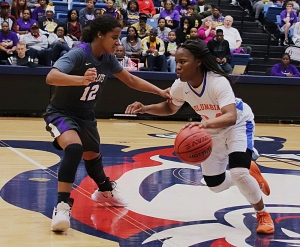 Columbia's Shontrice Austing (24) drives against Villa Rica's Aliyah Hindsman in Columbia's tough loss in the Class 5A girls' semifinal. (Photo by Mark Brock)