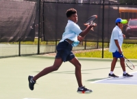 Chamblee's Bryce Starks teamed up with Carter DiFonzo for a 6-0, 6-2 win at No. 1 doubles. (Photo by Mark Brock)