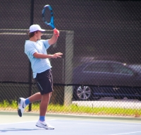 Chamblee's Hap Howell clinched the Bulldogs trip to the Class 5A state title match with his 6-4, 6-3 win at No. 3 singles over Buford's Luke Davidson. (Photo by Mark Brock)