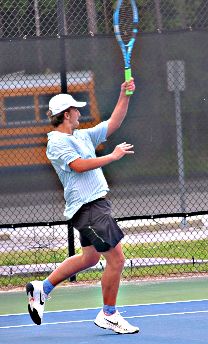 Chamblee's No. 3 singles player Hap Howell and his Bulldog teammates face off with Buford in the Class 5A semifinals. (Photo by Mark Brock)