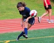 Dunwoody's Michaela Zusmann (16) lofts a corner kick towards the goal during Dunwoody's 3-0 win over Creekview. (Photo by Mark Brock)