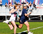 Dunwoody's Sadie Cramer (27) moves up the field against a North Springs defender. (Photo by Mark Brock)