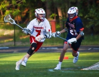 Dunwoody's Zach Rosing (7) comes around the net looking for a scoring opportunity against North Springs. (Photo by Mark Brock)