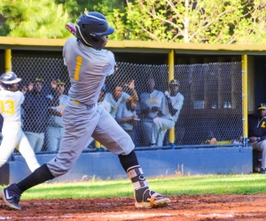 Lithonia's Bryson Suber lined a single to left in the bottom of the first inning of the Bulldogs loss to Southwest DeKalb. (Photo by Mark Brock)