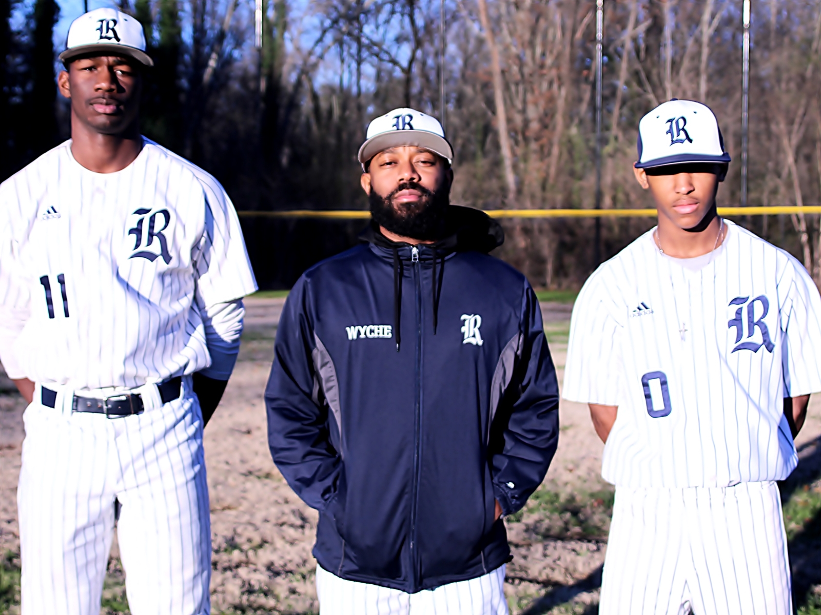 Redan's Donye Evans (l-r), Coach Alexander Wyche and Ryan Pruitt helped the Raiders to a 2-1 series win over Morgan County.