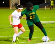 Stone Mountain's Say Wah (8) battles Clarkston's Martha Conteh (23) for possession of the ball. (Photo by Mark Brock)