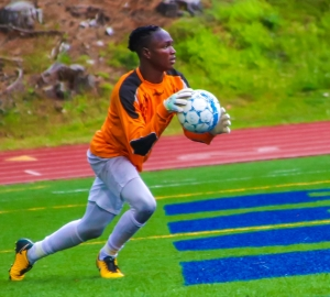 Stone Mountain goalie Byona Byaruhanga makes a save against Clarkston. (Photo by Mark Brock)