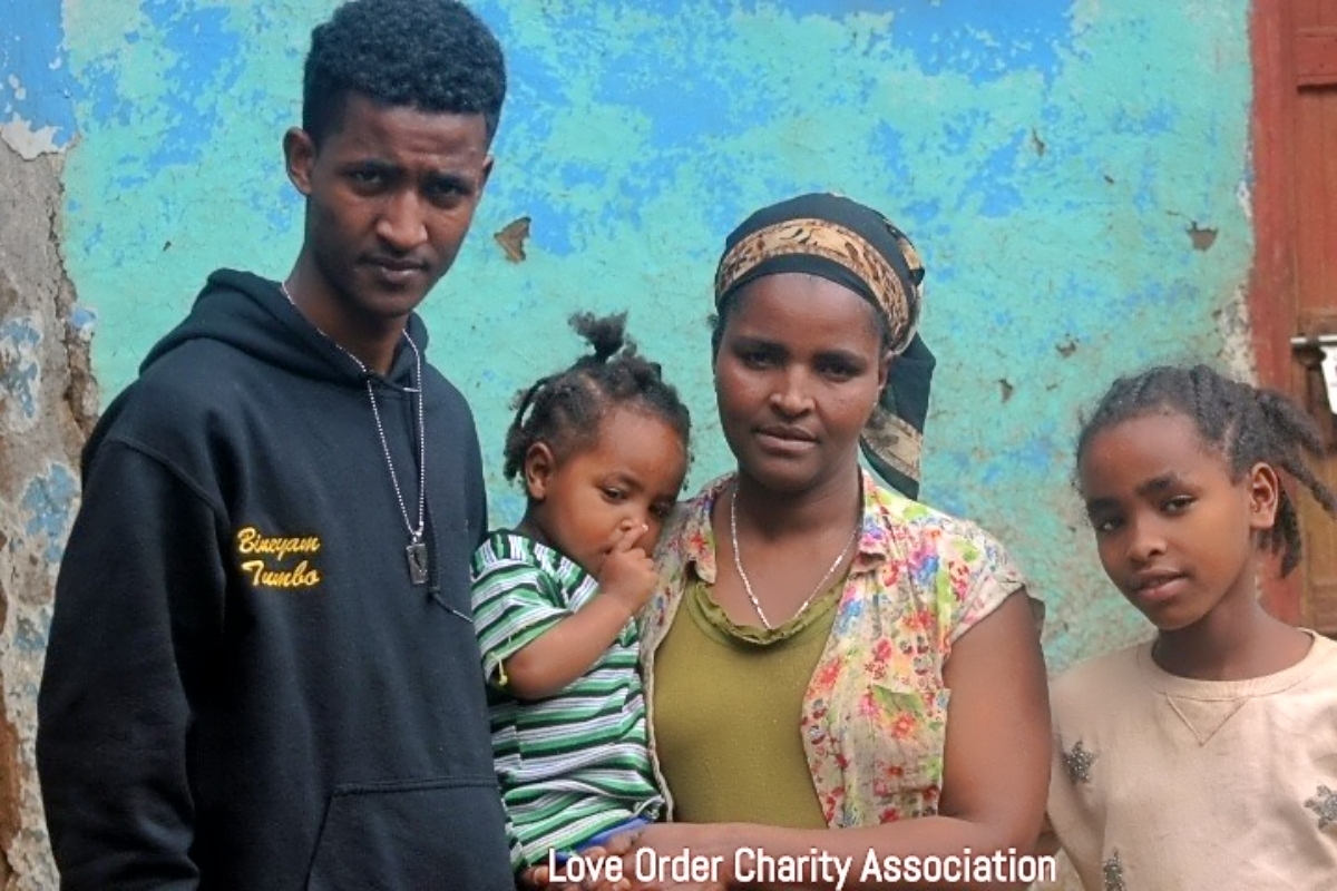 Former Clarkston cross country runner Bineyam Tumbo (far left) is finding ways to give back to his native Ethiopia while finished college. One way is serving the Love Order Charity Association and orphanages in Ethiopia.