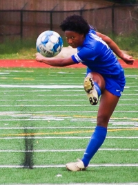 Chamblee's Savannah Lawrence lifts a direct kick towards the goal against Decatur in her team's 1-0 playoff loss. (Photo by Mark Brock)