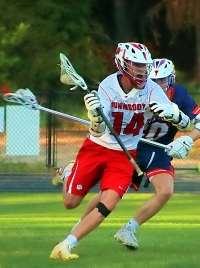 Dunwoody's Connor Brogdon (14), shown here against North Springs, had two goals and two assists in Dunwoody's historic 12-6 playoff victory over Harrison. (Photo by Mark Brock)